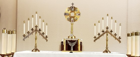 Monstrance on the altar with benediction candles.