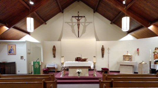View of the Sanctuary and back wall of St. John the Evangelist Parish Weston.  The picture is taken during ordinary time.