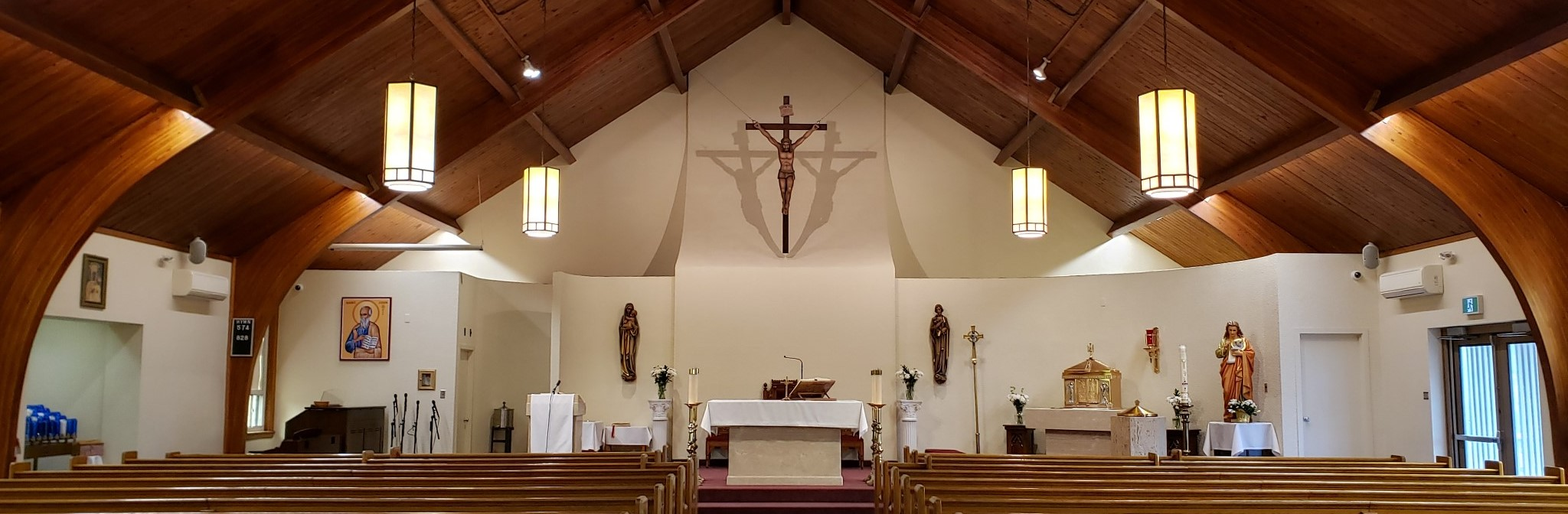 An inside view of the Sanctuary of St. John the Evangelist Parish, Weston.  Wide panoramic view from the candleside to the side doors of sanctuary.