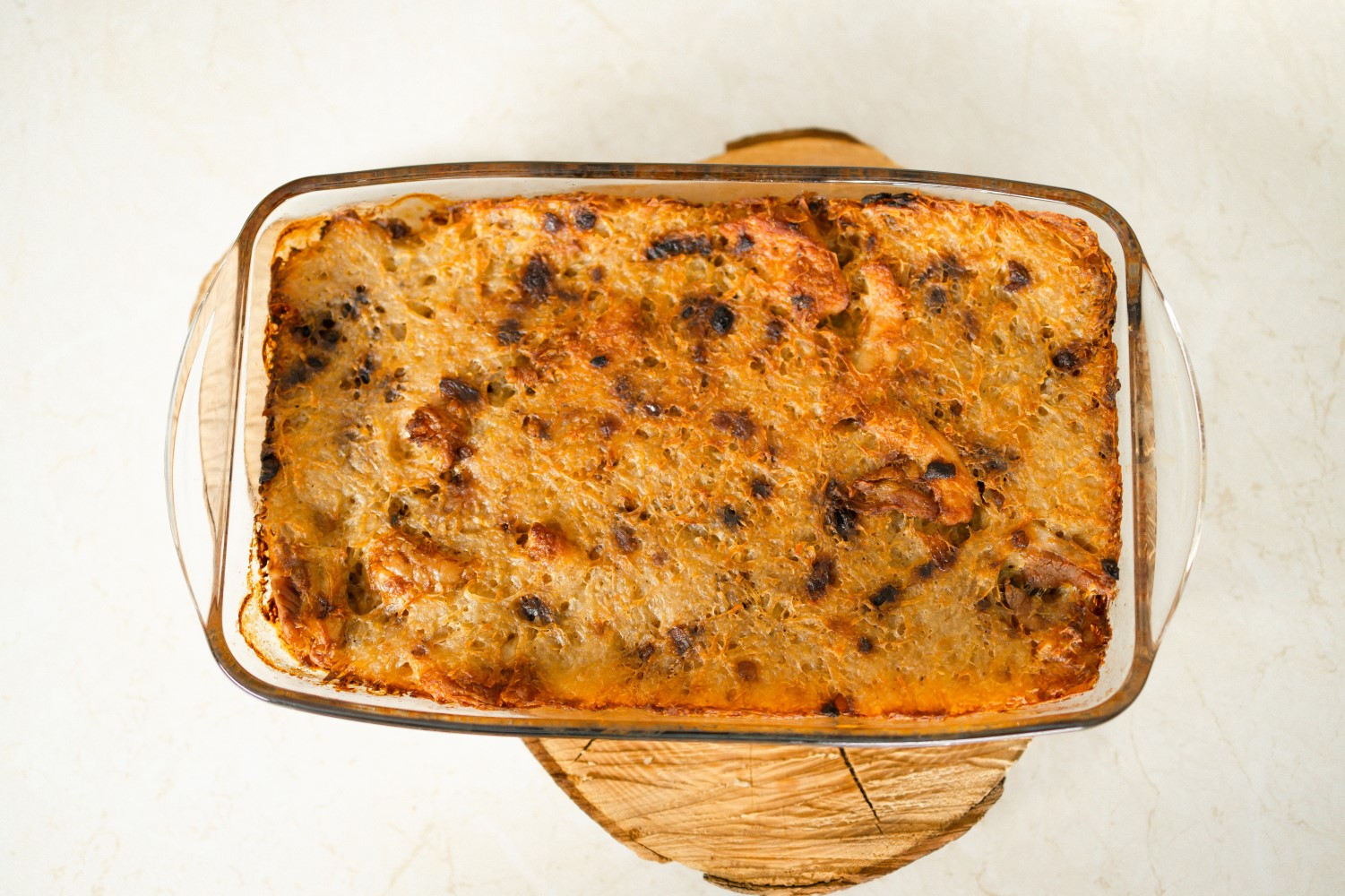 A casserole with crumb topping in a glass rectangular dish